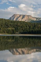 Mountains reflecting in black lake, Durmitor, Montenegro