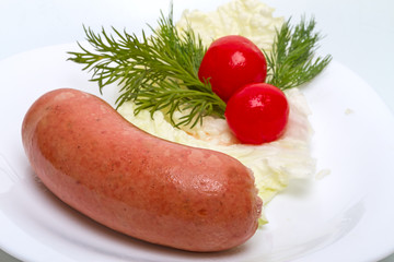 Cooked sausage with vegetables