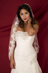 woman in a wedding dress on red serious expression