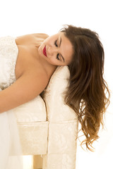 woman in wedding dress lay close eyes closed