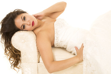 woman in wedding dress laying arm on neck looking