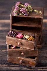 Dried herbs in wooden box