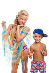 Brother and sister in a swimsuit bright color. Isolated.