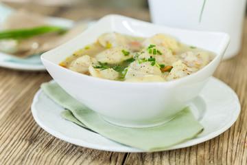Dish of savory pork tortellini in broth pelmeni russian