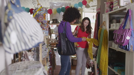 Happy and attractive young women shopping together