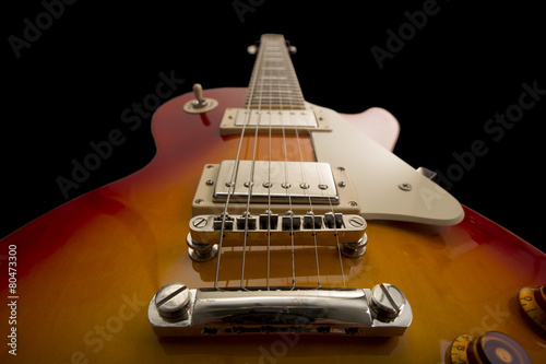 An electric guitar on a black background - 80473300