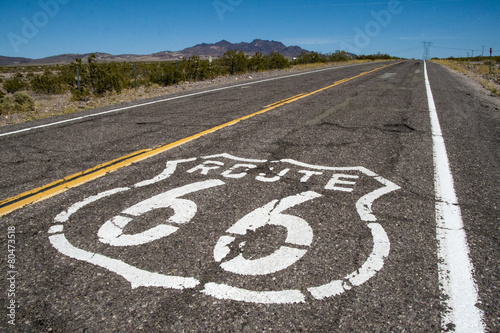 Foto op Plexiglas Route 66 long road with a Route 66 sign painted on it