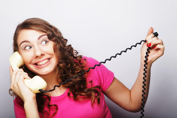 young happy woman with vintage phone