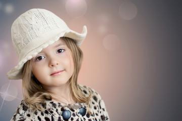 Kid's fashion background. Beautiful little girl closeup.