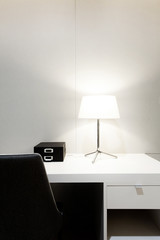 Workspace with desk lamp on home or studio