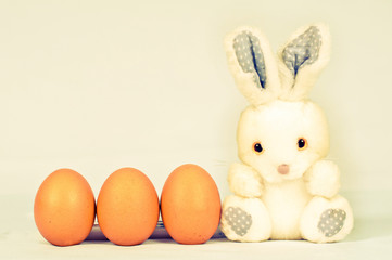 easter bunny with three eggs