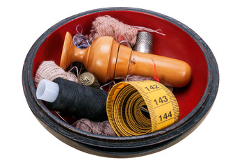 Wooden box with sewing accessories