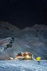 night shot of balea lake cabin