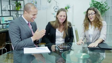 three professional business people get good news