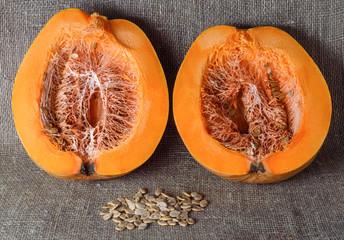 ripe orange pumpkin on burlap background