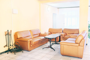 Brown leather chairs and sofa. Recreation room