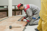 Home improvement, renovation - construction worker tiler is tili