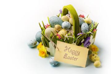 art Easter eggs basket on wooden background