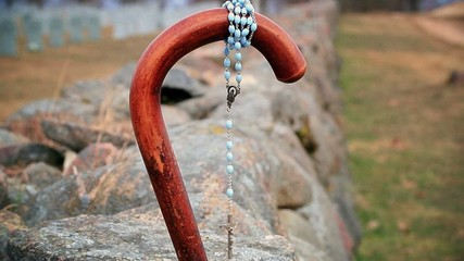 Walking stick with rosary