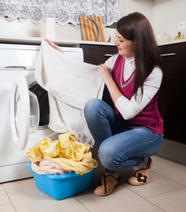 long-haired  woman doing laundry