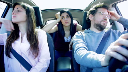 Three unhappy friends angry driving car