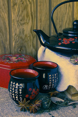 Tea drinking from a beautiful tea set.