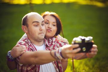 young couple Self, photos, old camera