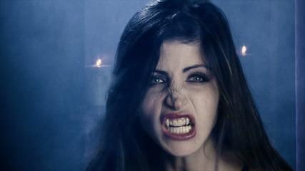 Beautiful angry sensual female vampire closeup slow motio