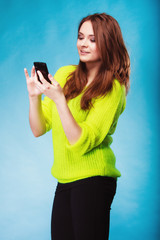 Teenage girl with mobile phone texting