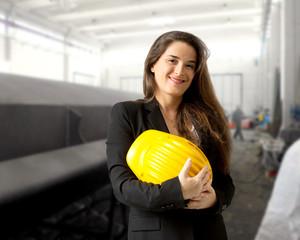 smiling industrial engineer withsafety helmet against industrial