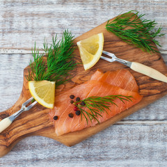 Smoked salmon with spices on a rustic background