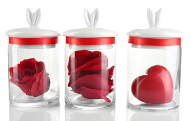 Rose flower, petals and decorative heart in glass jars