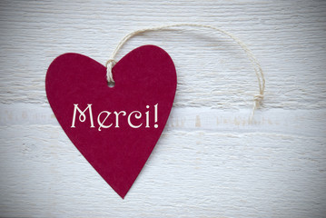 Red Heart Label With French Text Merci Means Thank You