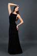 Beautiful young woman in long black dress