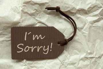 Brown Label With I Am Sorry Paper Background