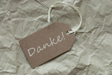 Beige Label With German Danke Means Thank You Paper Background