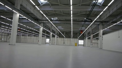 Flying through the big empty warehouse.