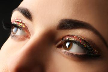 Portrait of beautiful woman with fancy glitter makeup