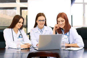 Medical workers working in conference room