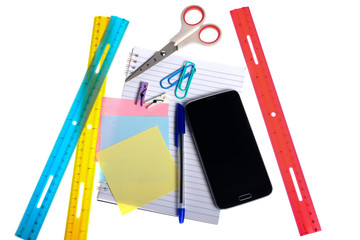 Variety of stationery items and a smartphone