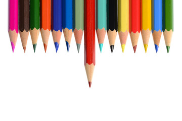 Front view of aligned coloring crayons isolated
