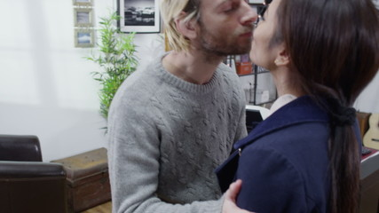 Husband sends his wife off to work with a kiss