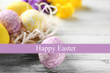 Easter composition with colorful eggs on wooden table