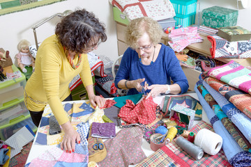 two women working on their quilting