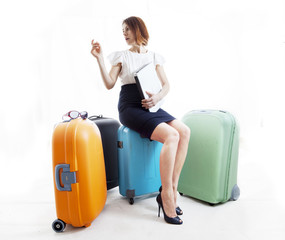 business woman with her suitcases consult a computer