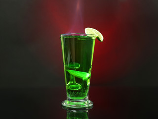 Flaming green cocktail on colorful background