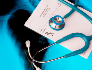 Empty medical prescription with a stethoscope on Xray