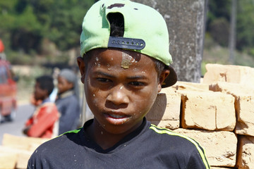 Hard working poor malagasy boy - poverty