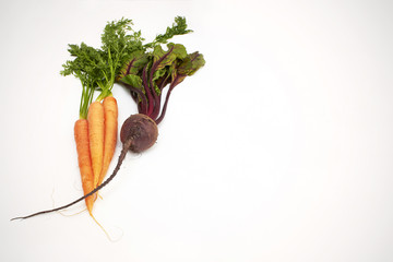 Fresh carrots and beetroot on whiteboard