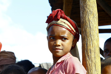 Very pretty malagasy child smiling in the vilage- poverty